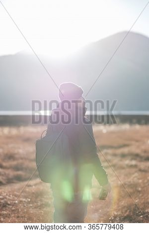 Hipster Woman Traveler With Sweater And Backpack Traveling At Napa Lake, Happy Film Photographer Tak
