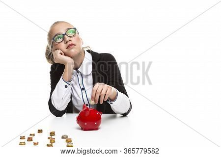 Children Frugal Concepts. Portrait Of Thoughtful Dreaming Teenage Girl Wearing Glasses. Posing With