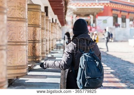 Hipster Woman Traveler With Sweater And Backpack Traveling In Shika Snow Mountain, Happy Asian Touri