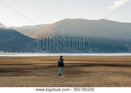 Hipster Woman Traveler With Sweater And Backpack Traveling At Napa Lake, Happy Young Hiker Looking M