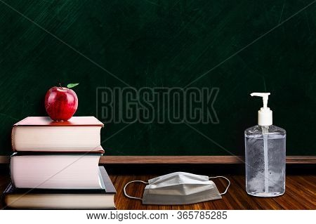 Back To School During Covid-19 Pandemic With Classroom Setting Of Apple On Books To Signify Educatio