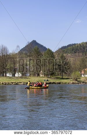 Szczawnica, Poland - April 20, 2019: Rafting On The Dunajec River, Wooden Raft Trip, Great Tourist A