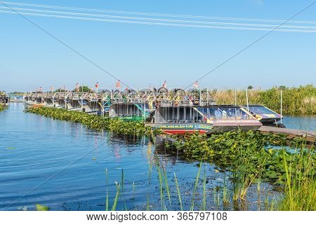 Everglades, United States Of America - April 27, 2019: Tourist Airboats Moored In Slender Rows Await