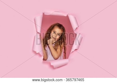 Portrait Of Cute Caucasian Little Child Girl Thinking Or Daydreaming About Something In Torn Paper P