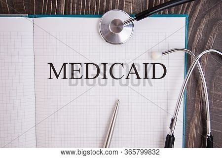 Notebook Page With Text Medicaid, On A Table With A Stethoscope And Pen, Medical Concept.