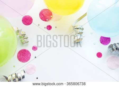 Happy Birthday Or Party Background.  Flat Lay With Birthday Baloons, Confetti And Ribbons On White B