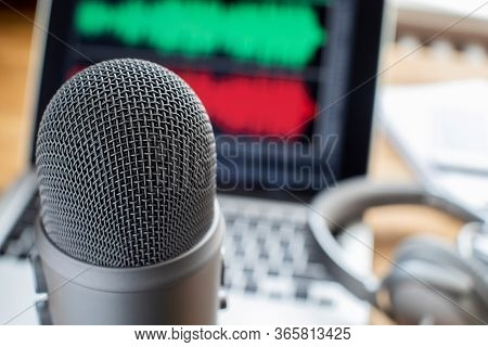 Close Up Of Microphone Laptop And Headphones For Broadcasting Podcast
