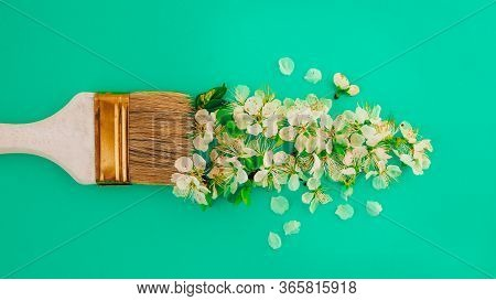 Spring Blossom Concept. Paint Brush With Apricot Cherry Blossom Flower On Green Background