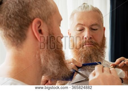 Handsome Mid Adult Man Cutting His Moustache And Beard By Himself In Front Of Mirror At Home. Beard