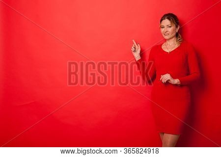 Woman Forty Years In A Dress On A Red Background