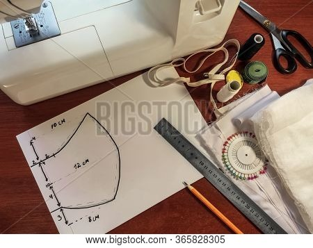 Pattern Of Medical Face Mask Drawn On A White Paper On The Background Of Sewing Accessories. Sewing