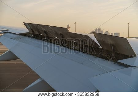 View From The Passenger Window - Wing Of An Airplane Landing Above The Runway At High Speed During T