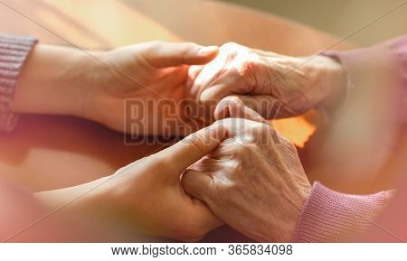 Elderly Hands. Helping Hands Of Young Adult And Senior Women. Care And Elderly Concept.