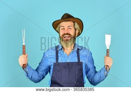 Farmer Promoting Bbq Equipment. Cooking Steak. Cooking Utensils. Summer Picnic. Bbq American Traditi