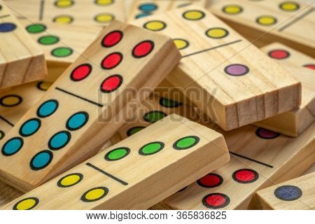 closeup abstract of wooden domino pieces with colorful pips (dots)