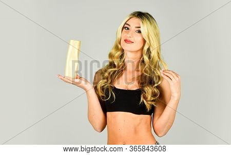 Pigment Enhances Cold Tint On Bleached Hair And Neutralizes Yellowness. Woman Long Hair Hold Shampoo
