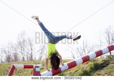 Happy Hipster Young Girl Having Fun, Girl Jumping And Smiling In Modern Clothes, Emotional Moment.yo