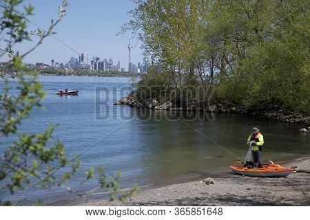 Toronto, Ontario / Canada - 05/21/2018: Taking A Rest From Kayaking On Lake Ontario