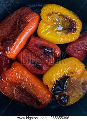 Red, Orange, And Yellow Bell Peppers Roasted With A Nice Char In A Cast Iron Skillet