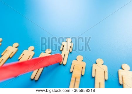 Selected Wooden Figure On Blue Background. The Concept Of Finding An Employee In Business. Hr Manage