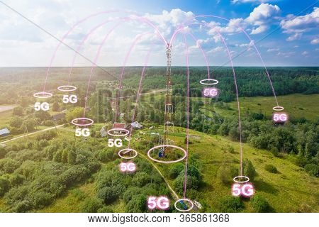 Telecommunication Tower With Radio Antennas And Satellite Dishes Is Installed On The Rural On The Gr