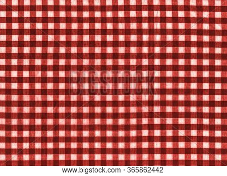 The Texture Of The Bright Red Of Binding Gingham Fabric. Red Textile Background. Fabric Plaid. Close