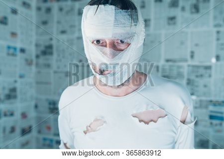 Victim Of Tabloid Journalism And Fake News Infodemic, Conceptual Image Of Man Wrapped In Bandages Su