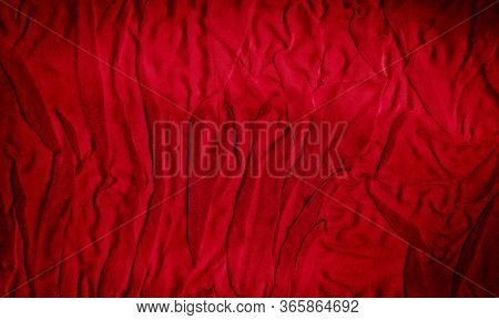 Bright Red Texture Of Binding Crumpled Fabric. Red Textile Background With Natural Folds. Close-up
