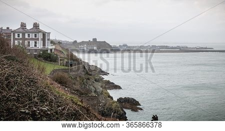 Distant View Of A Small Touristy Fishing Port  Of Howth, Ireland