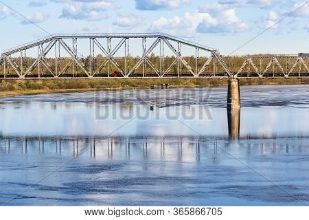 Railway Bridge Over The Volkhov River. Spring View Of The Province On A Sunny Day.