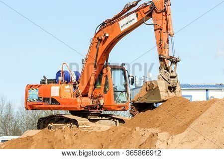 Kirishi, Russia - 8 May, Excavator On A Pile Of San, 8 May, 2020. Start Of Construction Of A Motor B