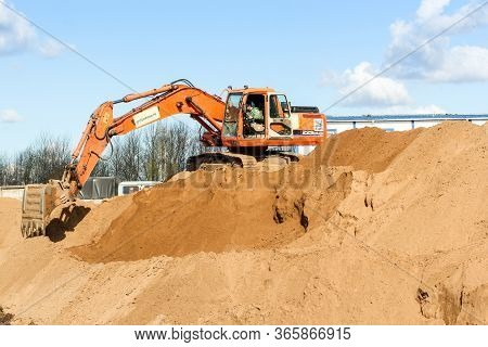 Kirishi, Russia - 8 May, An Excavator Works With A Pile Of Sand, 8 May, 2020. Start Of Construction