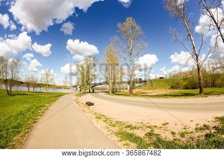 The Road Near The River. Spring View Of The Province On A Sunny Day.