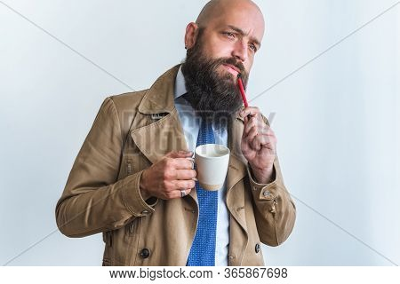 Bearded Businessman Portrait. Businessman Face Portrait. Businessman Portrait With Coffee Cup And Pe