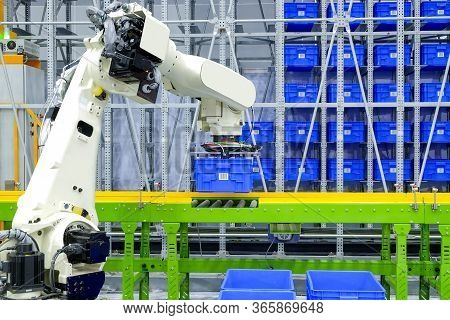 Industrial Robotic Gripping Blue Plastic Box Container Put On Conveyor For Transport To Storage On S