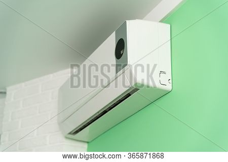 Air Conditioning On A Green Wall. Cleaning, Diagnostics And Repair Of Air Conditioning