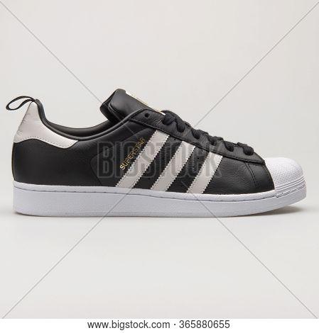 Vienna, Austria - August 13, 2018: Adidas Superstar Black And White Sneaker On White Background.