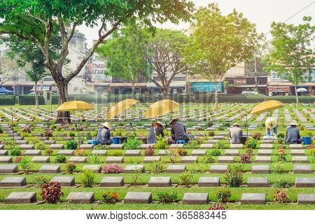 Kanchanaburi Thailand - February 21 : Unidentified Workers Renovate And Decorate Flowers At Kanchana