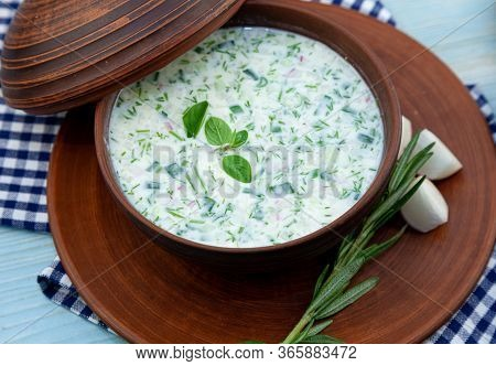 Okroshka - Summer Cold Soup. Cold Soup With Fresh Cucumbers, Radishes, Potato And Sausage. Tradition