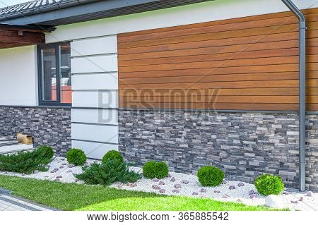 Cladding Of A House Made Of Wood And Decorative Brick