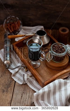 A Cup Of Coffee On A Wooden Tray. Turk And Coffee Beans. Cook Breakfast At Home. Still Life With A D