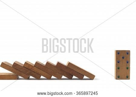 Social Distancing Concept Wood Domino Toys On White Background, . Domino Effect. 8 Dominos Is Fallin