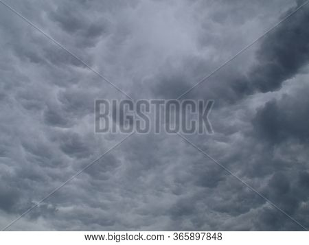Rain And Thunder Clouds, Texture, Background. Stormy, Grey, Lead Sky Before The Rain And Rainstorm.