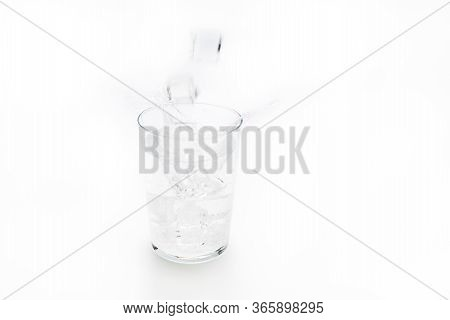 Refreshing Tonic Drink By Pouring Ice Into The Glass. Refreshing Drink Concept
