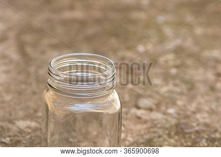Close Up Of Empty Glass Jar Isolated.