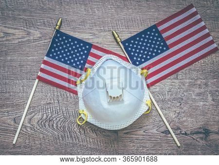 Concept. Two Mini American Flags And N95 Mask