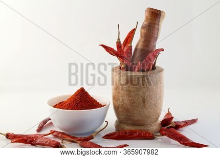 Red Chillies With Red Chilly Powder On White Background