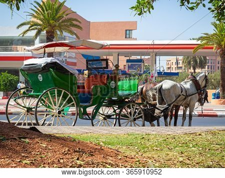 Marrakesh, Morocco - 12 October, 2019: Decorated Horse-drawn Carriage Awaiting Tourists On The Sunny