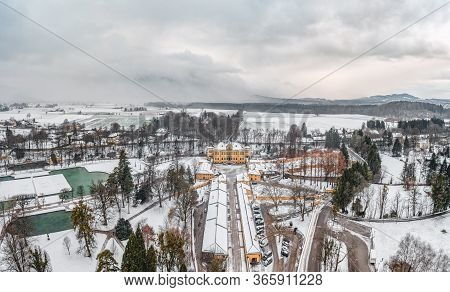 Aerial View Of Schloss Hellbrunn Covered In Snow View Of Snow Mountain Untersberg Near Salzburg Outs