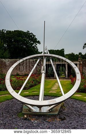 Giant Sundial In Gardens Of Herstmonceux, East Sussex, England. Brick Herstmonceux Castle In England